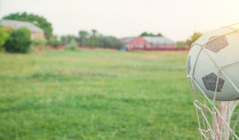 Voetbalbal in het net van een doel royalty-vrije stock foto's