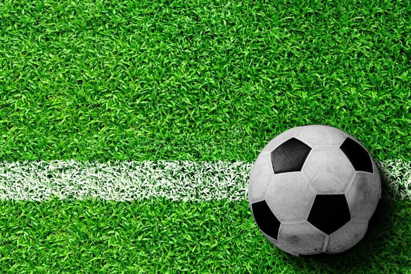 Voetbalbal op Gebied met Exemplaarruimte royalty-vrije stock afbeelding