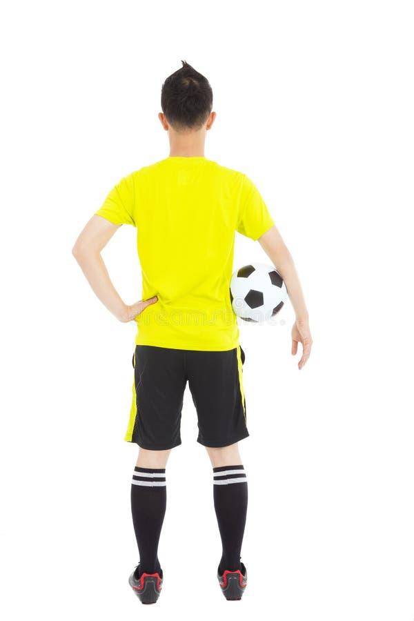 Download Voetballer Die Een Voetbal Naast Taille Houden Stock Foto - Afbeelding bestaande uit vrede, greep: 39103322