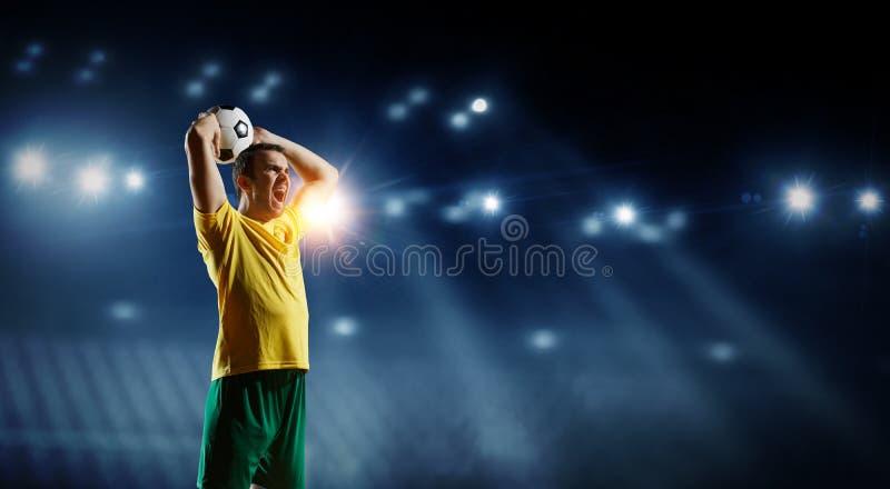 Voetballer op stadion in actie Gemengde media royalty-vrije stock foto