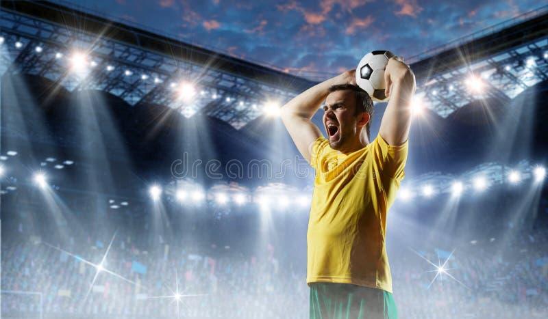 Voetballer op stadion in actie Gemengde media stock fotografie