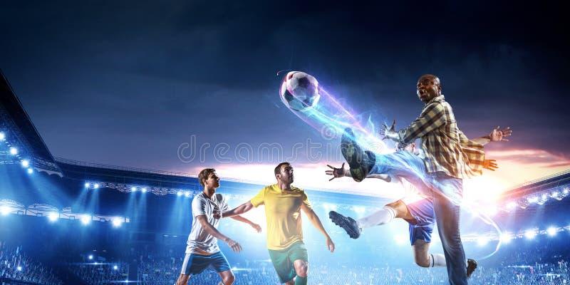 Voetbalmens in actie met bal Gemengde media stock foto's