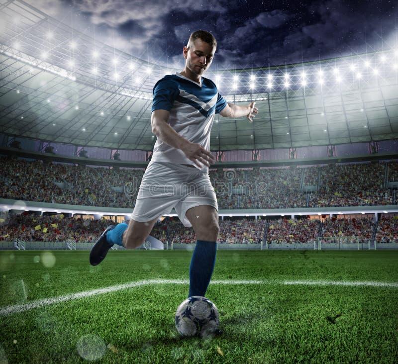 Voetbalscène met concurrerende voetbalsters bij het stadion stock foto
