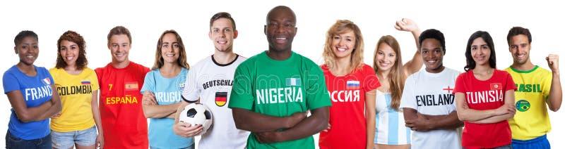 Voetbalventilator van Nigeria met ventilators van andere landen royalty-vrije stock afbeelding