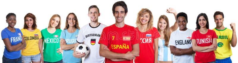 Voetbalventilator van Spanje met ventilators van andere landen royalty-vrije stock afbeeldingen