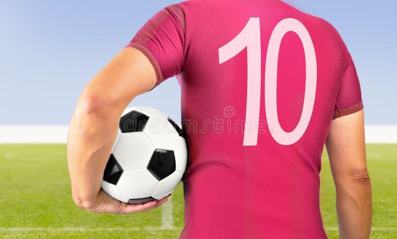 Voetbalvoetbalster in rood team stock foto