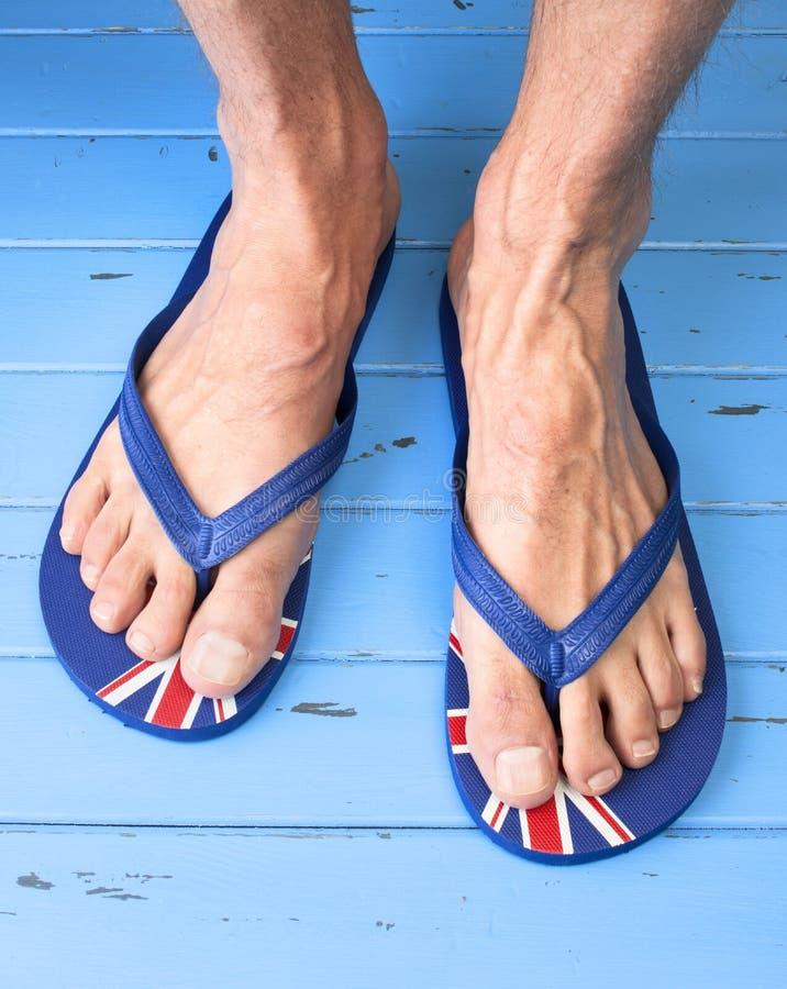 Voeten Leren riemenflip flops sandals royalty-vrije stock foto