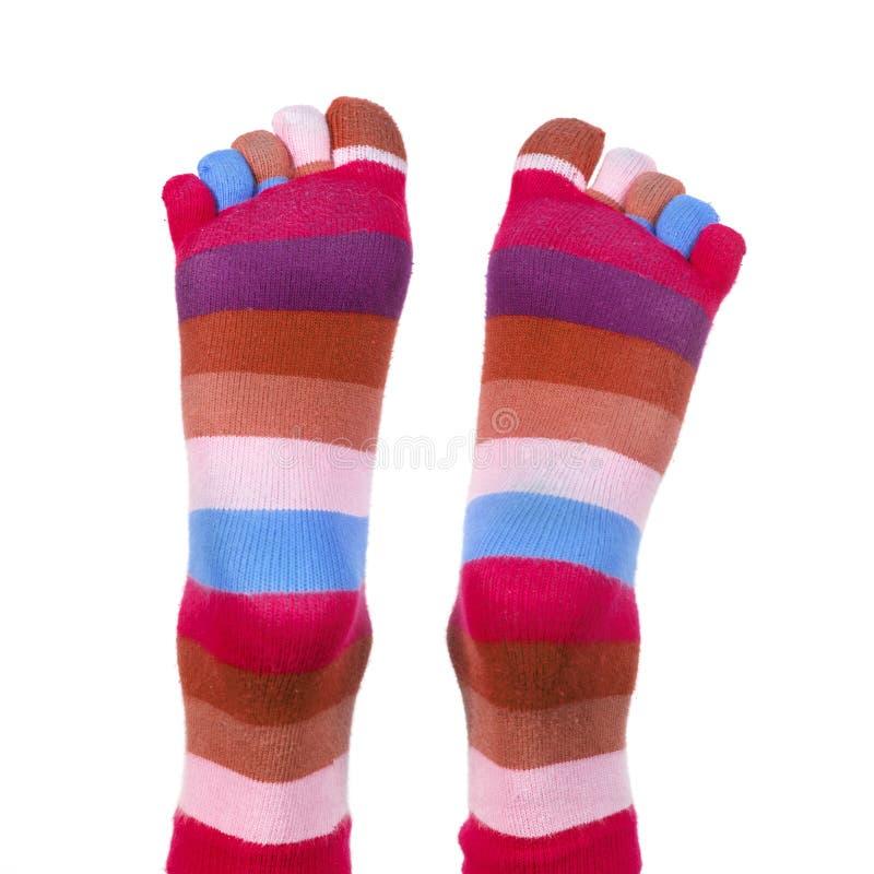 Voeten met gestreepte sokken royalty-vrije stock afbeelding