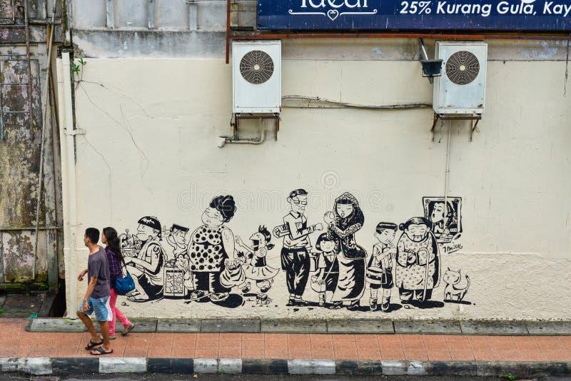 Voetganger en muurschildering op de straat stock foto