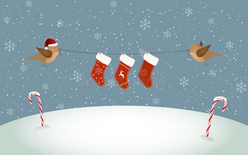 Vogels die de sokken van Kerstmis houden stock afbeeldingen