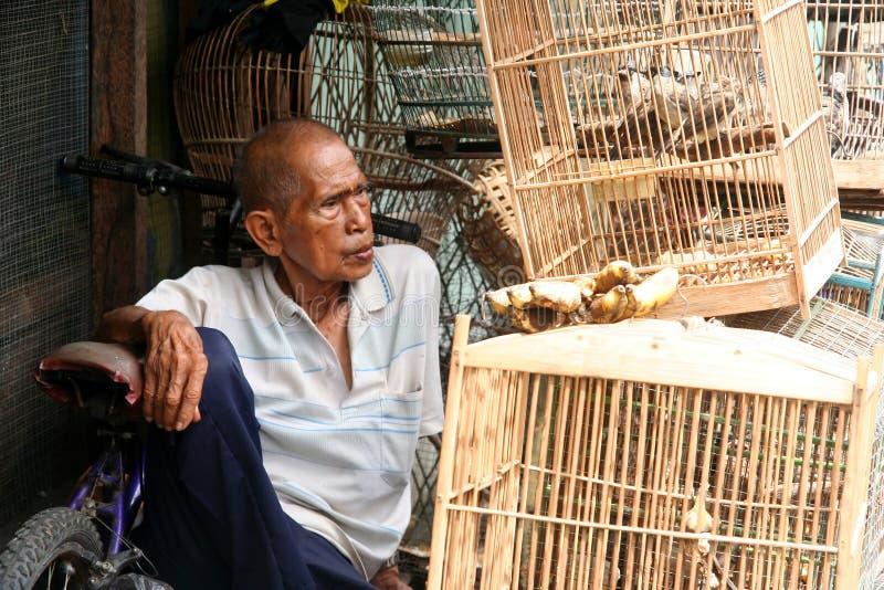 Vogelverkäufer lizenzfreie stockfotografie