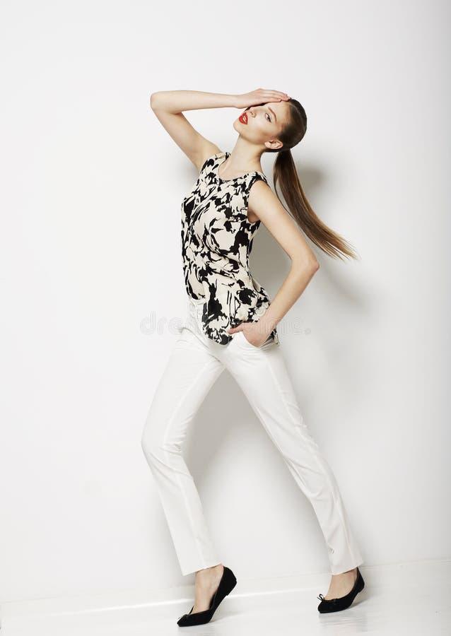 Vogue. Fêmea moderna que veste calças na moda. Coleção da fôrma imagem de stock royalty free