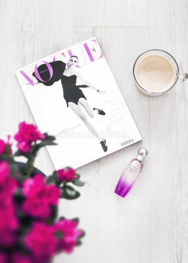 Vogue Magazine Beside Perfume Bottle stock images