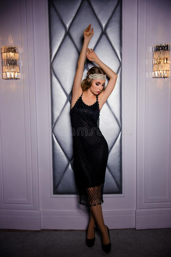 Vogue sexy retro woman in black dress and lace bandage royalty free stock image