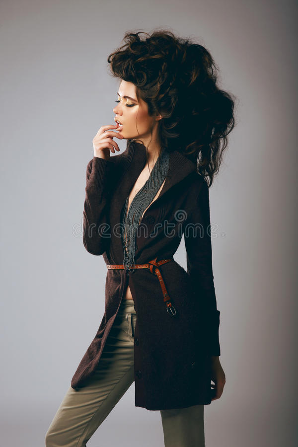 Vogue Style. Classy Fashion Model in Stylish Brown Jacket and Pants stock photo