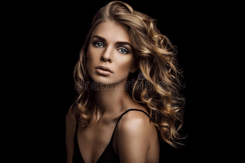 Vogue style close-up portrait of beautiful woman with long curly hair stock images
