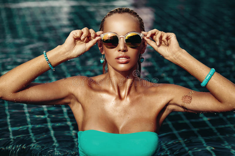 Vogue style fashion portrait of beautiful chic woman in water royalty free stock image