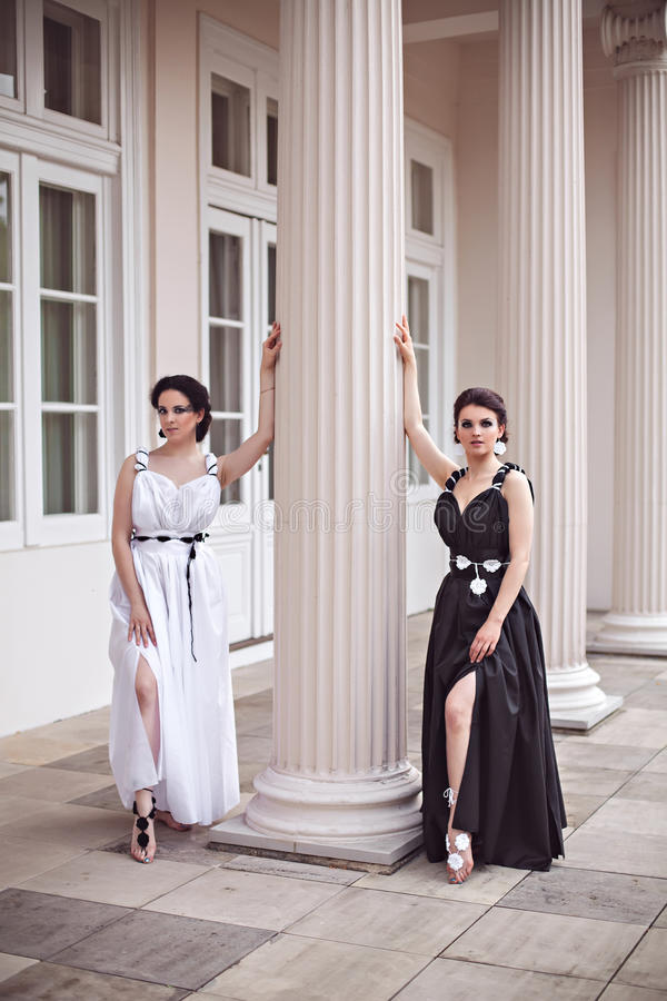 Vogue style photo of two fashion ladies royalty free stock photo