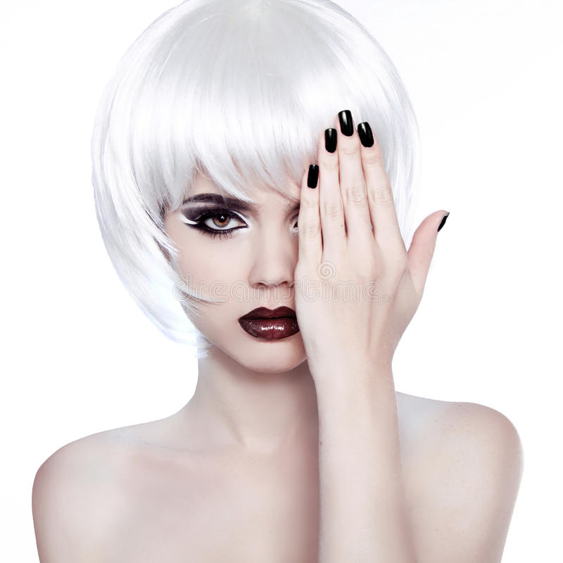 Vogue Style Woman. Fashion Beauty Woman Portrait with White Short Hair. Hairstyle. Manicured polish nails. royalty free stock photo