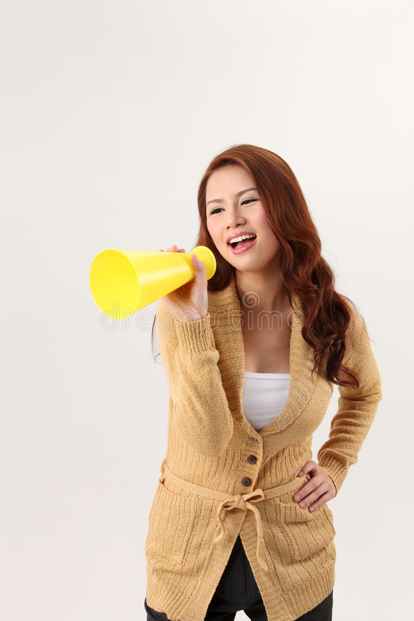 Voice out. Woman screaming into the bullhorn royalty free stock photography