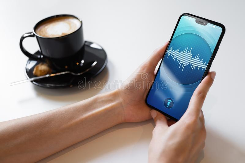 Voice recognition application on smartphone screen. Artificial intelligence and deep learning concept. Voice recognition application on smartphone screen royalty free stock photography