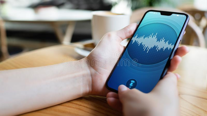 Voice recognition application on smartphone screen. Artificial intelligence and deep learning concept. Voice recognition application on smartphone screen royalty free stock image