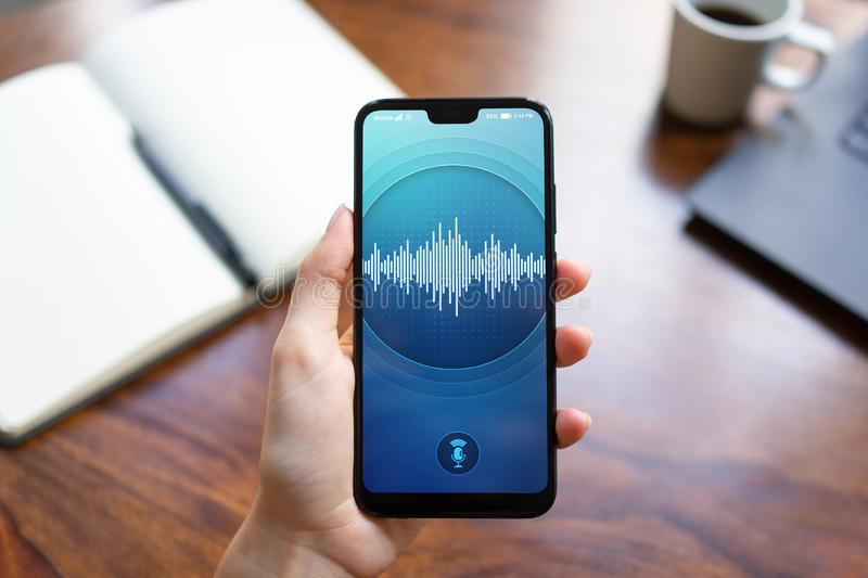 Voice recognition application on smartphone screen. Artificial intelligence and deep learning concept. Voice recognition application on smartphone screen stock images
