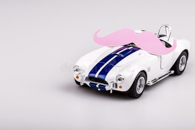 Voiture bleue et blanche de Bautiful, roadster avec la moustache images stock