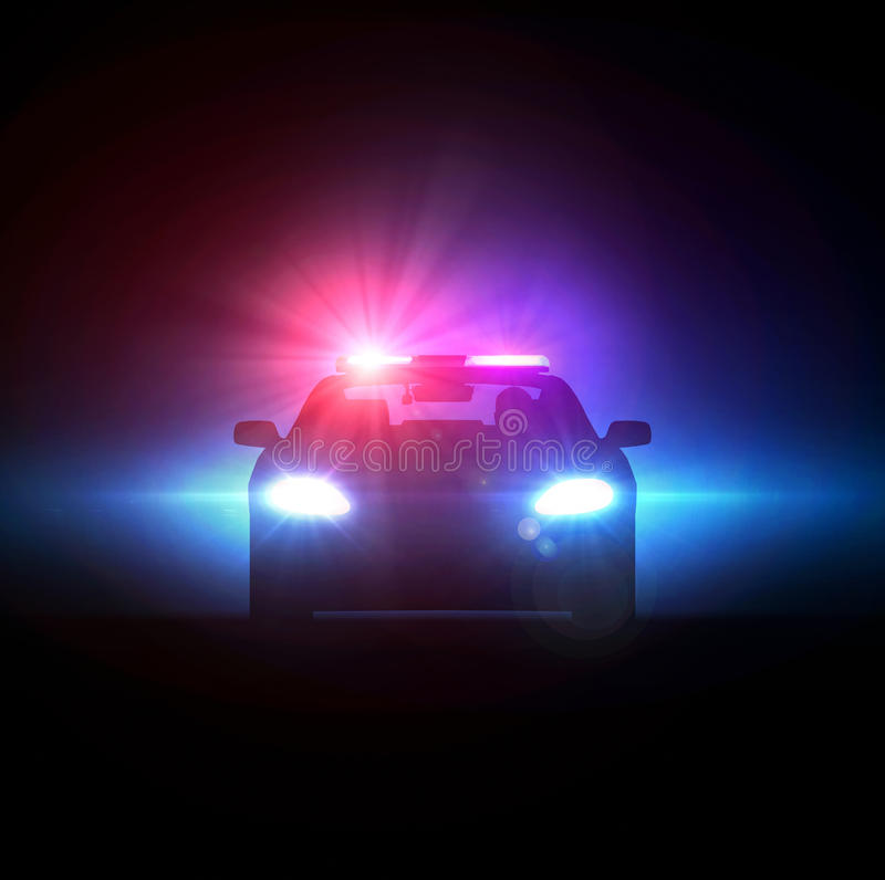 Voiture de police poursuivie dans l'obscurité photographie stock libre de droits