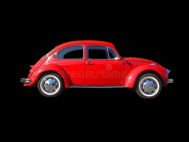 Voiture rouge de scarabée d'isolement sur le fond noir image stock