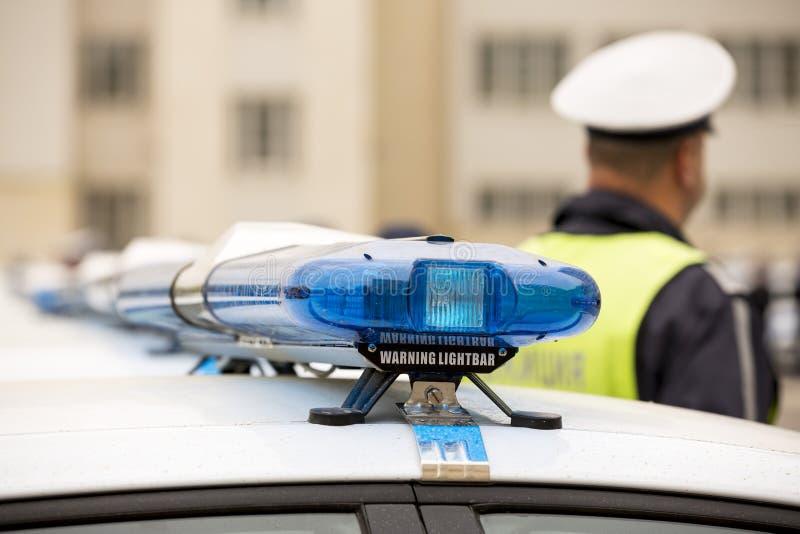 Voitures de policiers avertissant des lightbars photographie stock