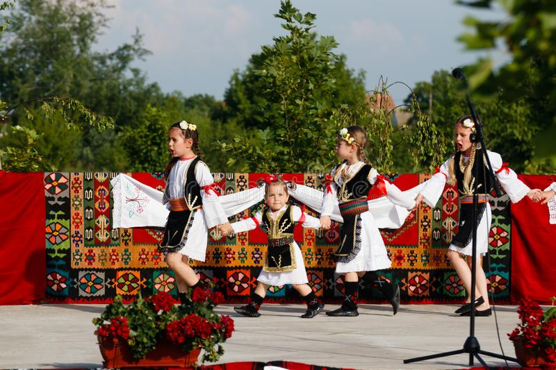Vojvodina, Serbia- June 16,2019 : Cute kids attending the parade in authentic costumes stock image