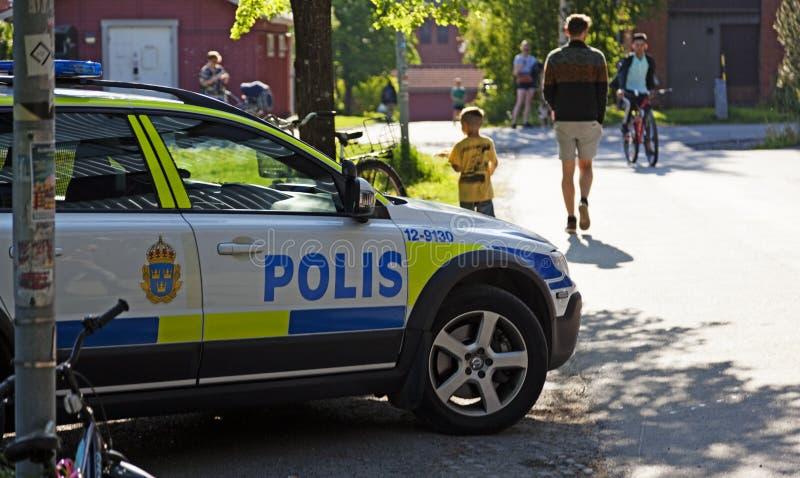 Volante della polizia a Alidhemsdagen in Umea fotografia stock