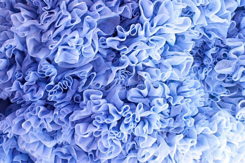 Volantes azules de la tela del fondo fotografía de archivo libre de regalías