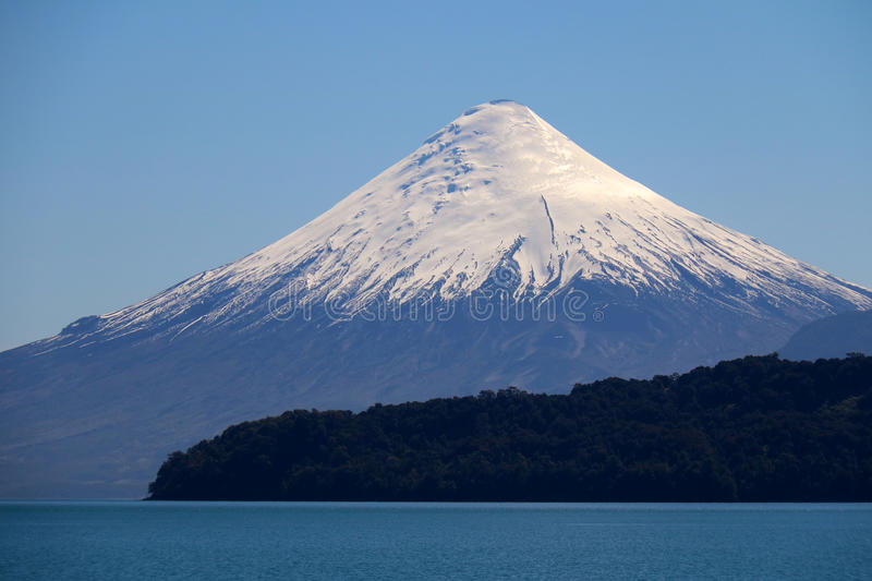 Volcan Osorno in Chile. Symmetric Volcan Osoro in Chile seen from a cruise boat on Lago Todos Santos. This route takes tourists from Puerto Varas in Chile to royalty free stock images