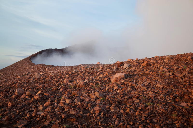 Volcan Telica. The crater of Volcan Telica spewing hot ash out near Leon in Nicaragua at sunrise royalty free stock image