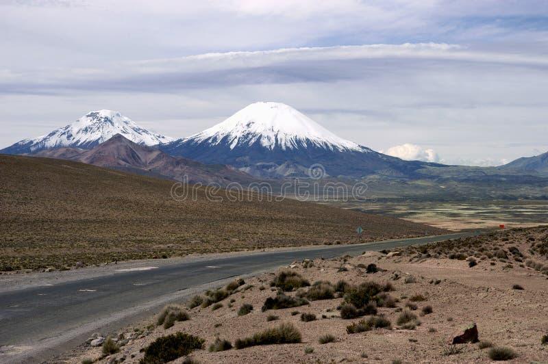 Volcanes y Parinacota Pomerape fotos de archivo