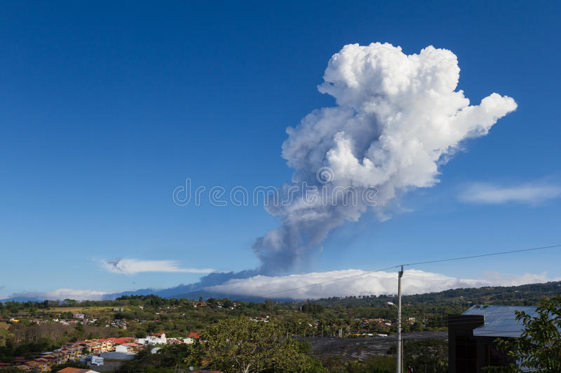 Volcanic activity form Poas, Costa Rica. Heredia, Costa Rica - April 14: Plum of steam and ash from volcanic activity towering above the Poas Volcano and stock photography