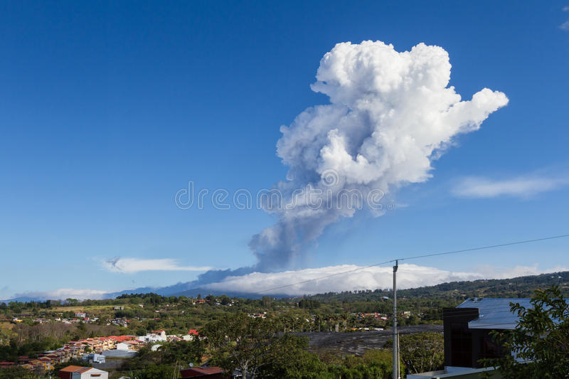 Volcanic activity form Poas, Costa Rica. Heredia, Costa Rica - April 14: Plum of steam and ash from volcanic activity towering above the Poas Volcano and royalty free stock photos
