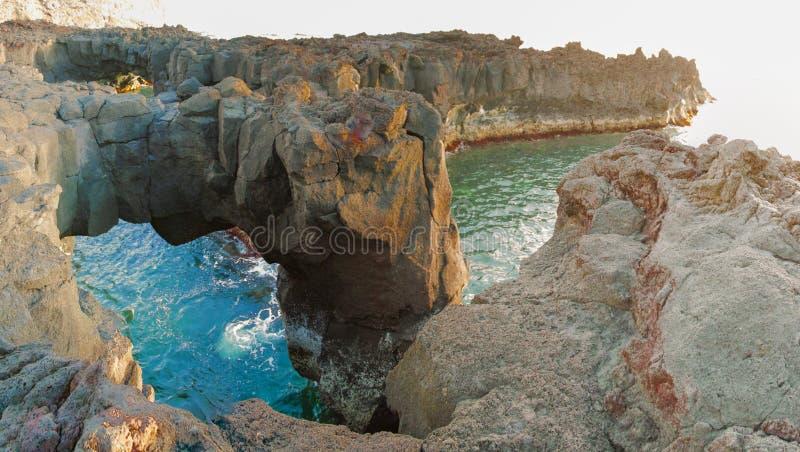 Volcanic arch panorama in Ponta da Ferraria stock photography