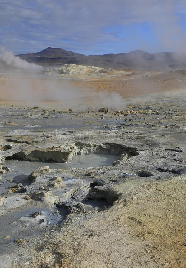 Volcanic boiling mud pots in Iceland. Fumaroles with volcanic boiling mud pots surrounded by sulfur hot springs in Hverir Namafjall geothermal place in Iceland royalty free stock photography