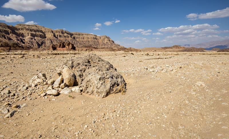 Volcanic bomb in geological Timna Park. Geological Timna Park is located 25 km north of Eilat ans combines ancient history, unique geology and variety of sport royalty free stock photography