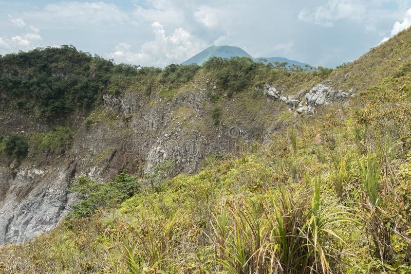 Volcanic crater and lake of Mount Mahawu Gunung Mahawu, North Sulawesi, Indonesia royalty free stock photo