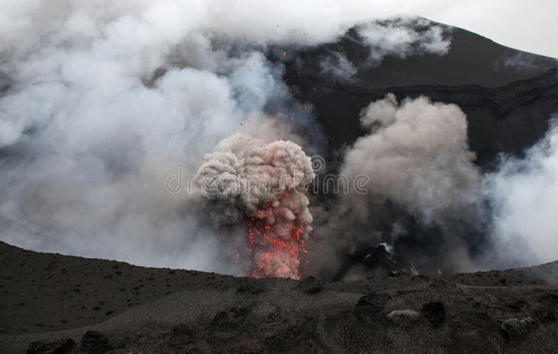 Volcanic erruption - Mount Yasur - Tanna Island Vanuatu. This volcano on the small tropical island is one of the most accesible i. Mount Yasur on the Vanuatu stock image