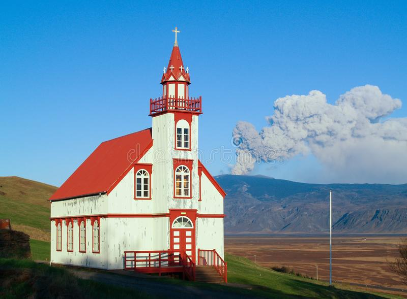 Eyjafjallajokull volcano, Iceland. Volcanic eruption with church in foreground. Hlidarendi church and Eyjafjallajokull glacier and vocano royalty free stock photos