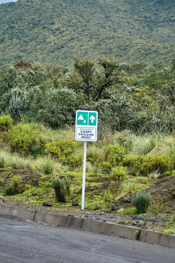Volcanic eruption evacuation sign on Cotopaxi Volcano. In the national park in Ecuador royalty free stock photography