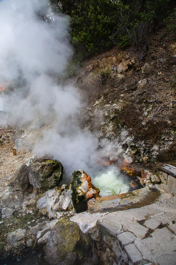 Volcanic eruption of hot steam in Furnas, Sao Miguel island, Azores archipelago. Volcanic eruption of hot steam in the town Furnas, Sao Miguel island, Azores royalty free stock images