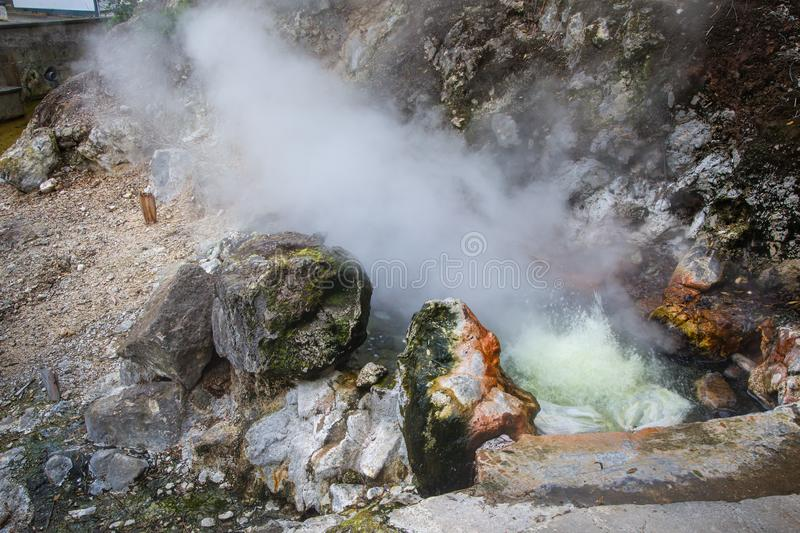 Volcanic eruption of hot steam in Furnas, Sao Miguel island, Azores archipelago. Volcanic eruption of hot steam in the town Furnas, Sao Miguel island, Azores royalty free stock photo