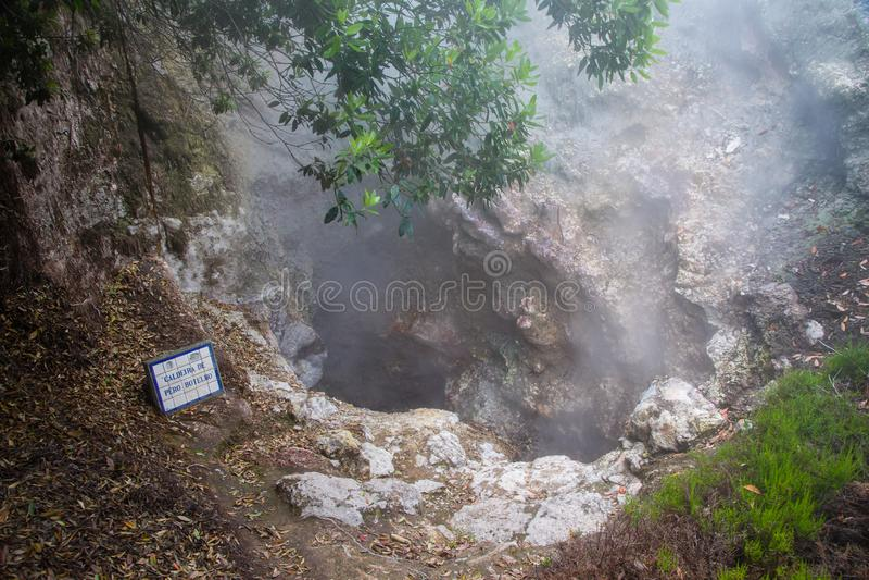 Volcanic eruption of hot steam in Furnas, Sao Miguel island, Azores archipelago. Volcanic eruption of hot steam in the town Furnas, Sao Miguel island, Azores stock photo