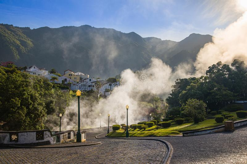 Volcanic eruption of hot steam in Furnas, Sao Miguel island, Azores archipelago. Volcanic eruption of hot steam in the town Furnas, Sao Miguel island, Azores royalty free stock image